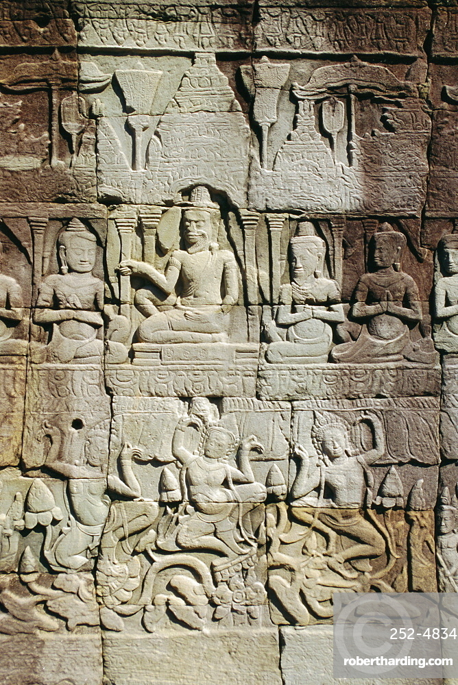 Stone bas-reliefs depicting scenes of rural life and historical events, in the Bayon Temple complex, Angkor, Siem Reap, Cambodia