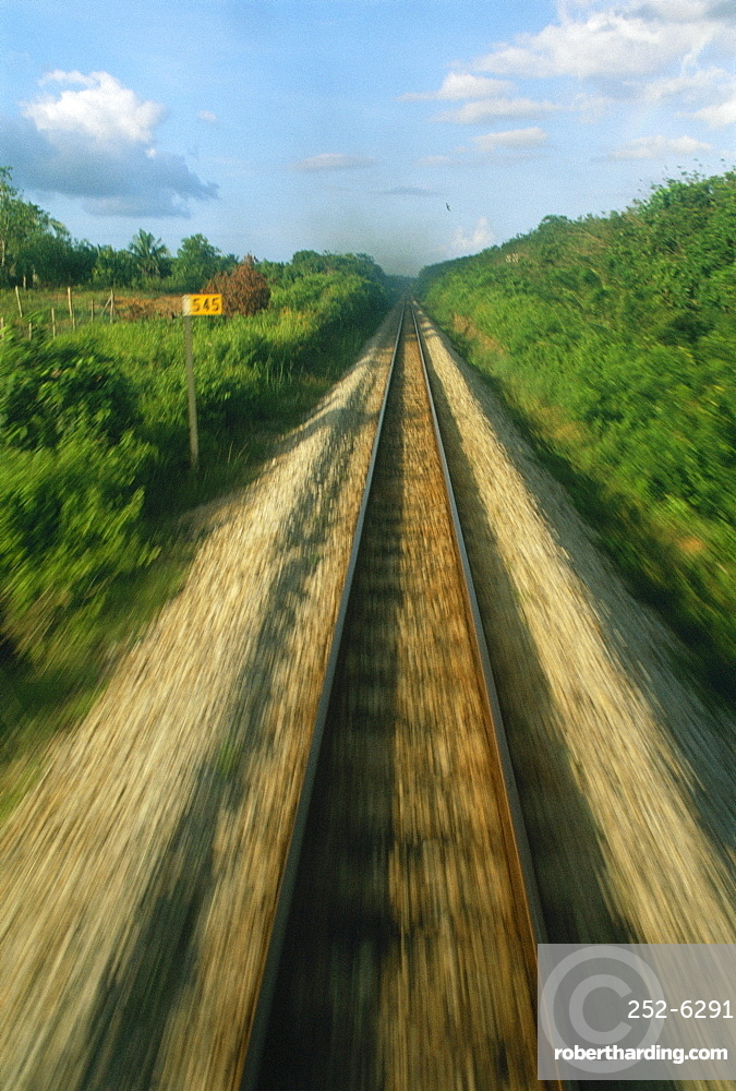 Single railway line seen from the train at speed *** Local Caption ***