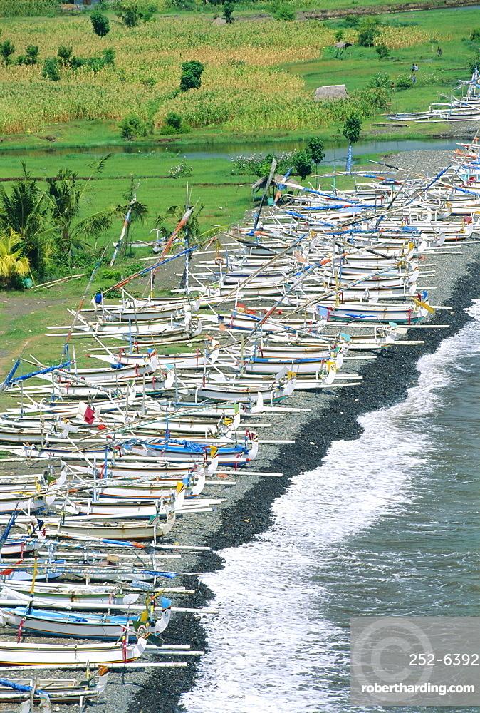 Colourful prahu (fishing boats) lining the beach, Amed, Bali, Indonesia