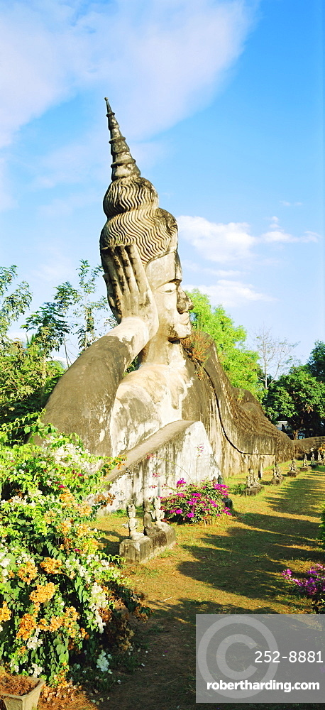 Reclining Buddha statue in the open at Xieng Khuan, Vientiane, Laos