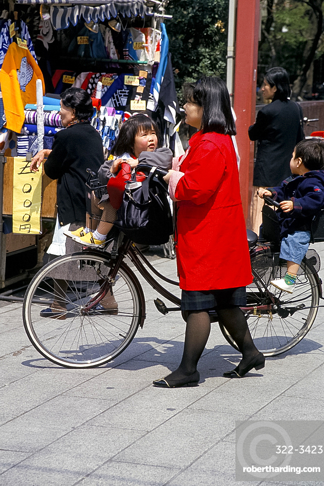 Mother and children with bicycle, Tokyo, Japan, Asia