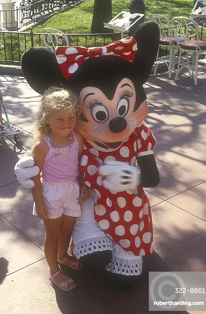 Young girl with Minnie Mouse, Disneyland, Anaheim, Los Angeles, California, USA *** Local Caption ***