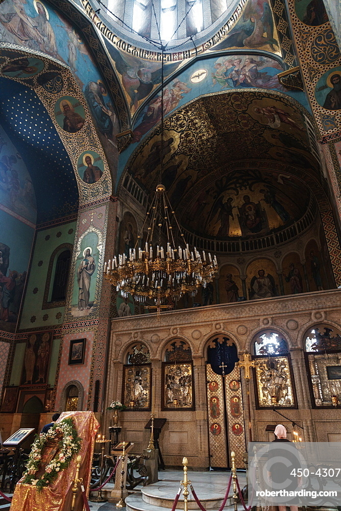 Worshipper at the altar of Sioni Cathedral, original built in 6th and 7th centuries, Old Town, Tbilisi, Georgia, Central Asia, Asia