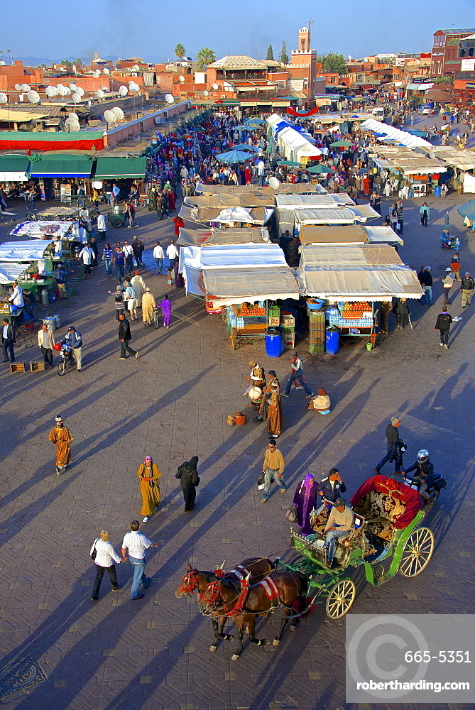 Restaurants, terraces, Kharbouch mosque and minaret, Jemaa-el-Fna Square, Marrakech, Morocco, North Africa, Africa