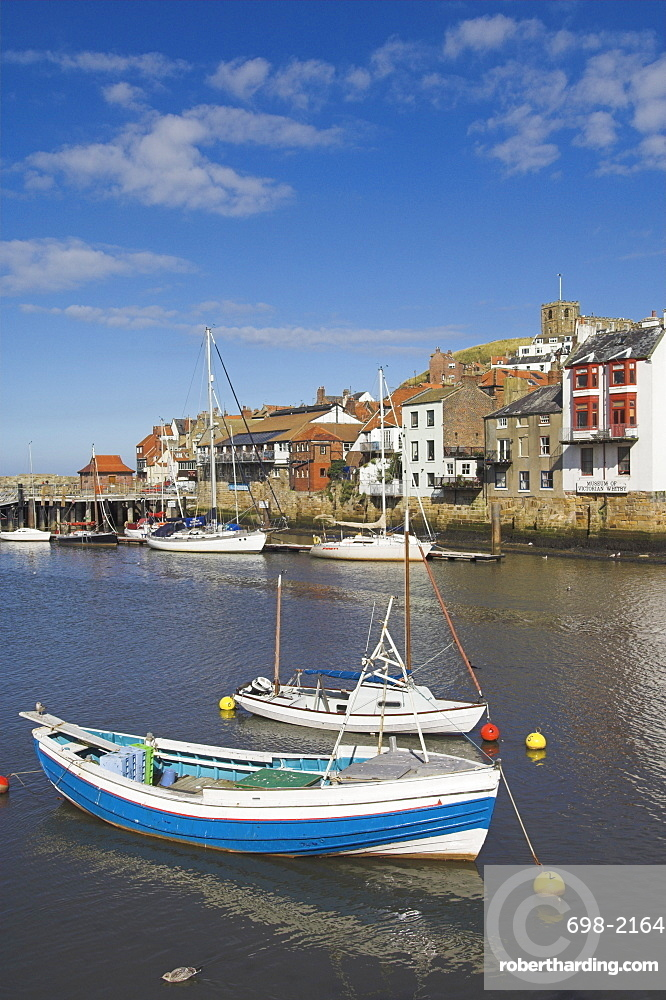 Whitby church and fishing boats in the harbour, Whitby, North Yorkshire, Yorkshire, England, United Kingdom, Europe