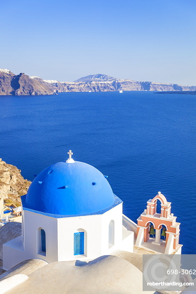 Greek church with blue dome and pink bell tower, Oia, Santorini (Thira), Cyclades Islands, Greek Islands, Greece, Europe