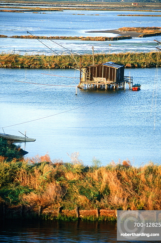 Italy, Emilia Romagna, River Po Delta, Comarchio, The Swamps, Huts And Nets Of The Eels Catchers