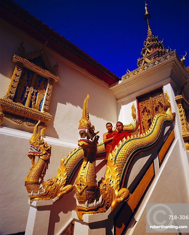 Staircase with Nagas (sacred snake) and two Buddhist monks, Wat Phrathat Doi Suthep, Chiang Mai, Thailand