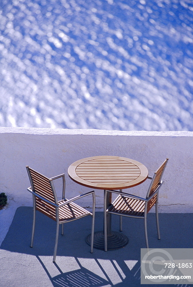 Cafe table and chairs, Thira (Fira), Santorini, Cyclades Islands, Greece, Europe