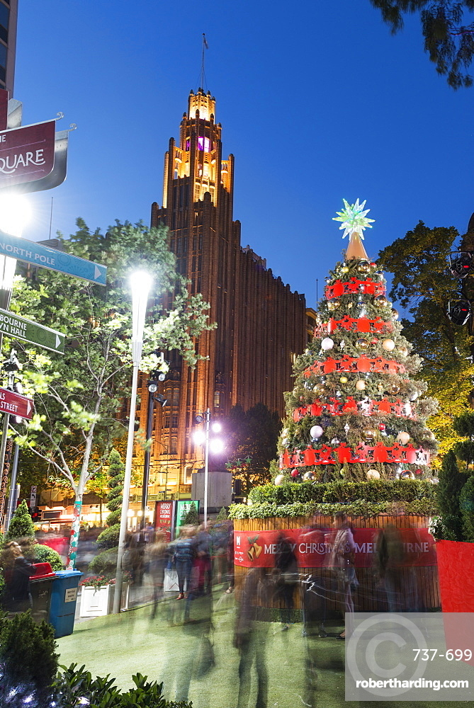 Christmas tree and decorations with Manchester Unity Building at City Square, Melbourne, Victoria, Australia, Pacific