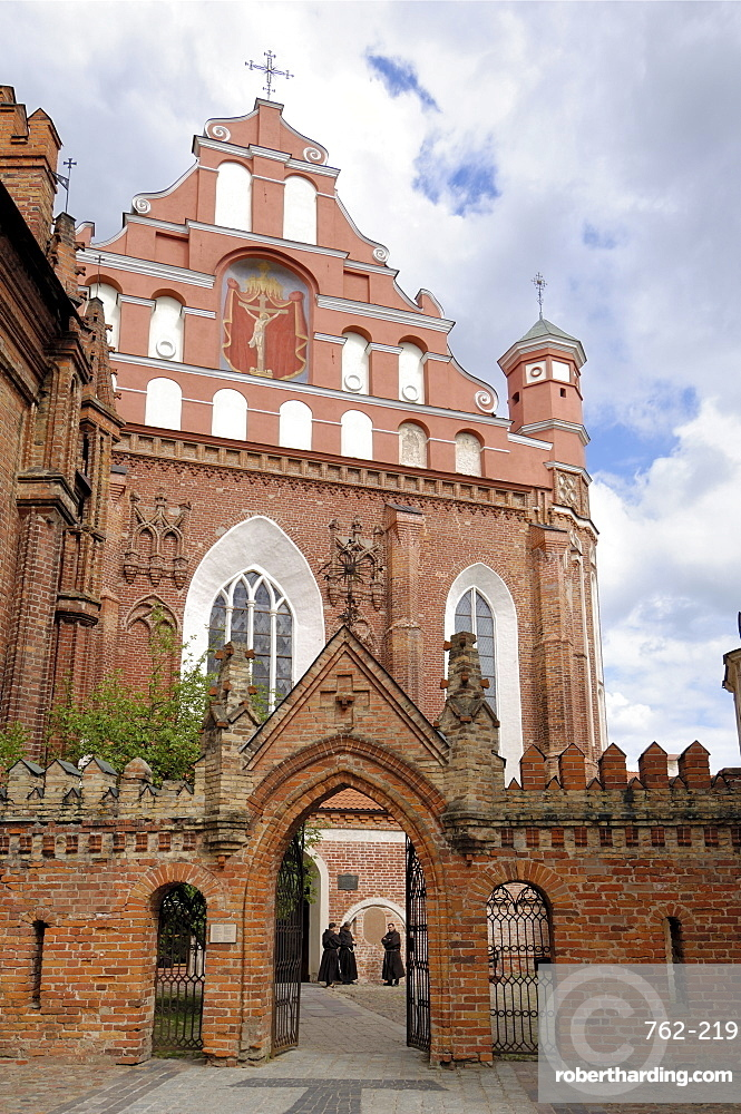 Bernardine church and monastery with monks standing by the door, Vilnius, UNESCO World Heritage Site, Lithuania, Baltic States, Europe