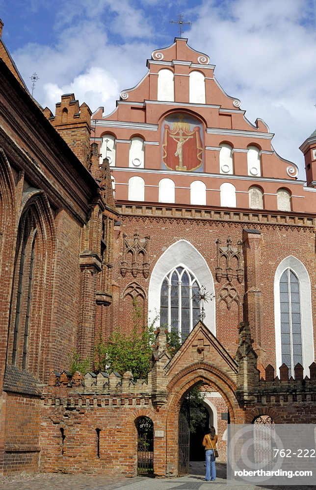 Bernardine church and monastery with a woman standing in the gateway, Vilnius, UNESCO World Heritage Site, Lithuania, Baltic States, Europe