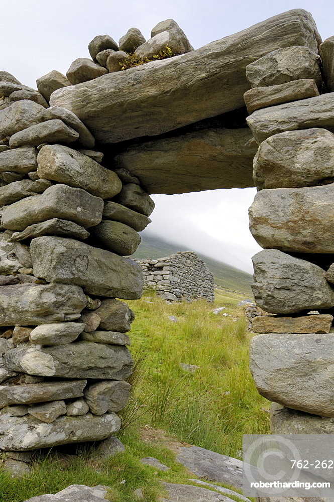 Deserted village at the base of Slievemore mountain, believed to have been abandoned during the great famine, Achill Island, County Mayo, Connacht, Republic of Ireland, Europe