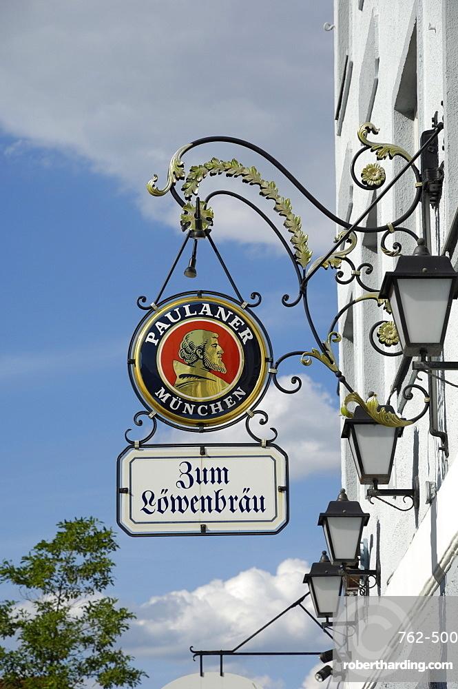 Wrought iron sign advertising Paulaner and Lowenbrau beer, Wolfrathausen, near Munich, Bavaria, Germany, Europe