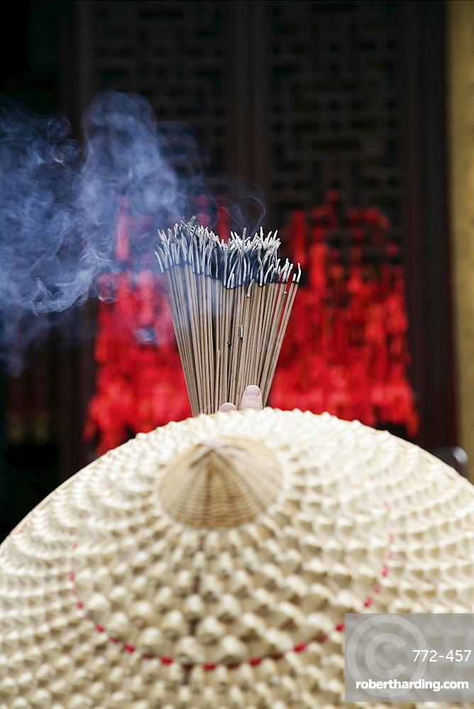 Chinese woman with incense sticks, Jade Buddha Temple, Shanghai, China, Asia