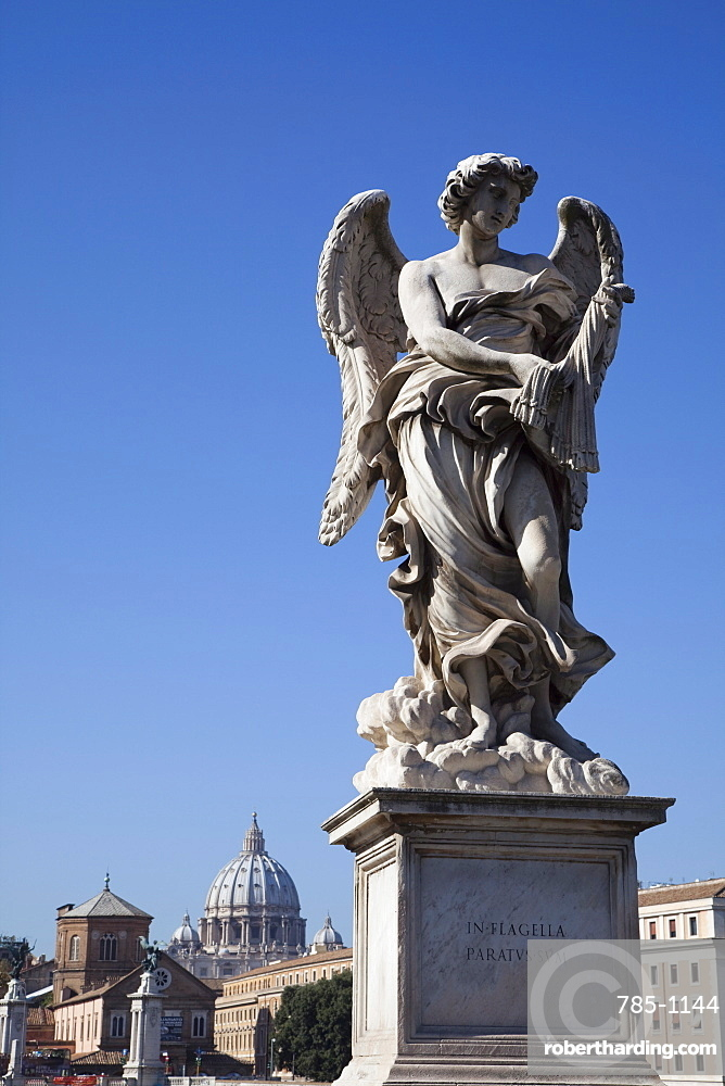 Angel statue on Ponte Sant' Angelo (Bridge of Angels), with the dome of the Vatican in distance, Rome, Lazio, Italy, Europe