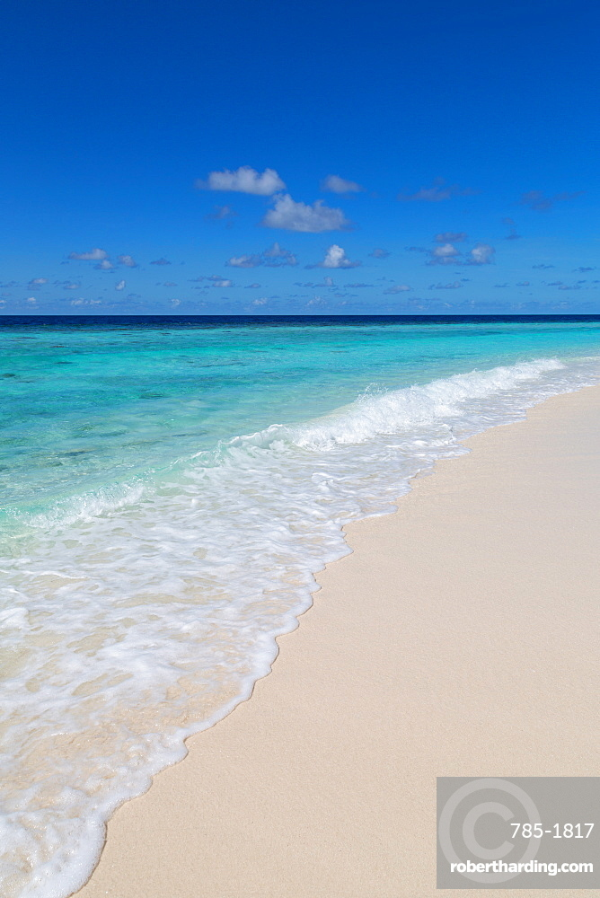 A beautiful deserted shoreline on an island in the Maldives, Indian Ocean, Asia