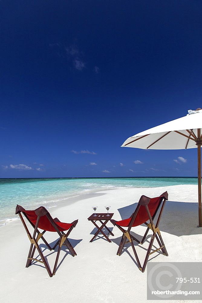 Martini and chairs on the beach, Maldives, Indian Ocean, Asia