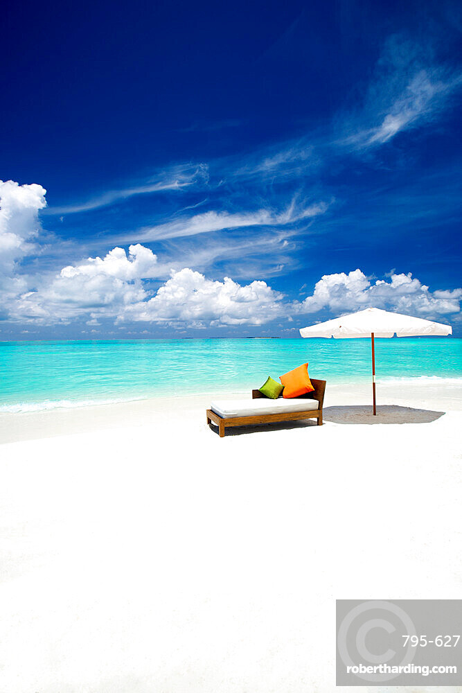 Sofa and parasol on tropical beach, The Maldives, Indian Ocean, Asia