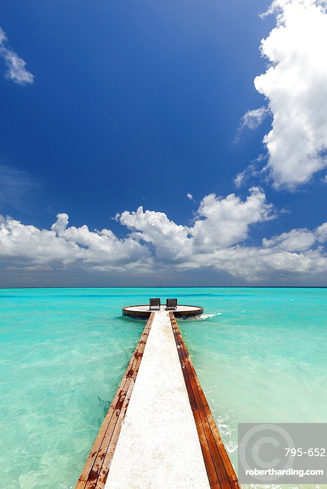 Jetty and chairs overlooking sea, The Maldives, Indian Ocean, Asia