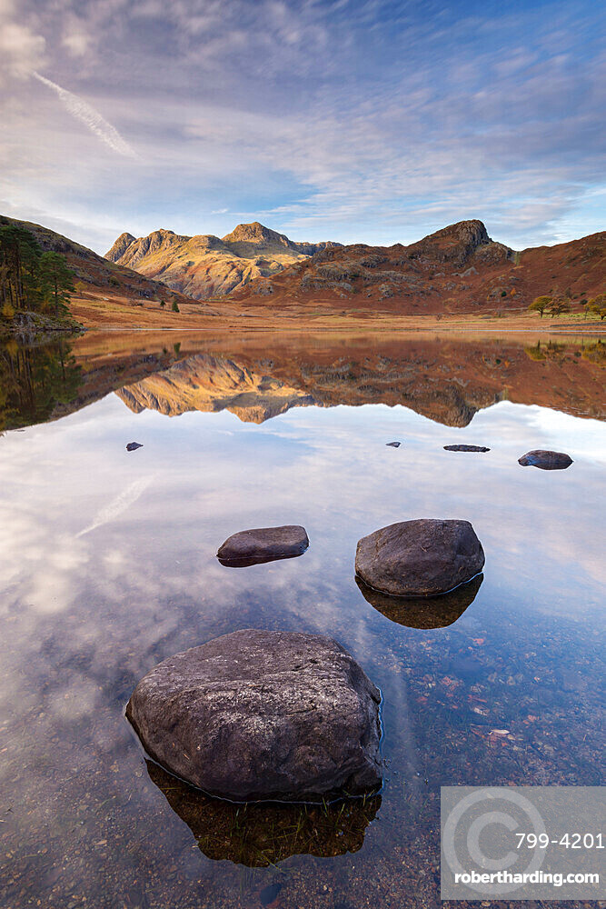 The Langdale Pikes mountains reflected in the mirror still water of Blea Tarn in autumn, Lake District National Park, UNESCO World Heritage Site, Cumbria, England, United Kingdom, Europe