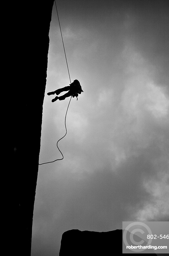 Climber abseiling off a wall, Tsaranoro Massif, southern Madagascar, Africa