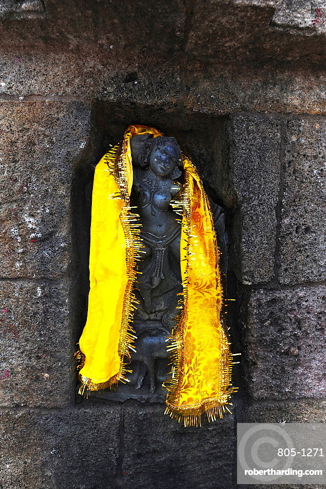 One of the 64 Jogini statues in the Chausathi Jogini Mandir, draped with a shawl as a puja, Hirapur, Odisha, India, Asia