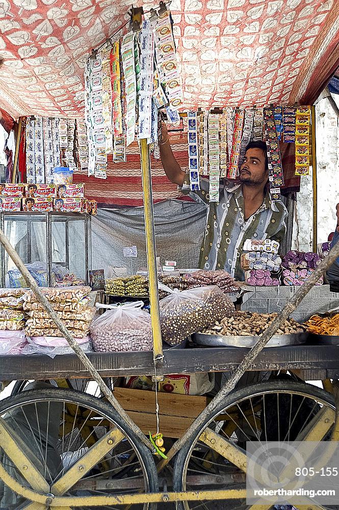 Stall holder selling gutka, namkeen snacks and bidi cigarettes, Kishangarh, Rajasthan, India, Asia