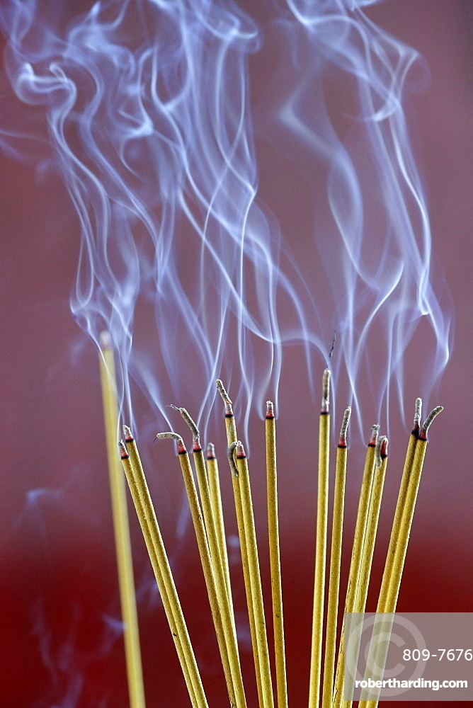 Incense sticks on joss stick pot burning, smoke used to pay respect to the Buddha, Vung Tau, Vietnam, Indochina, Southeast Asia, Asia