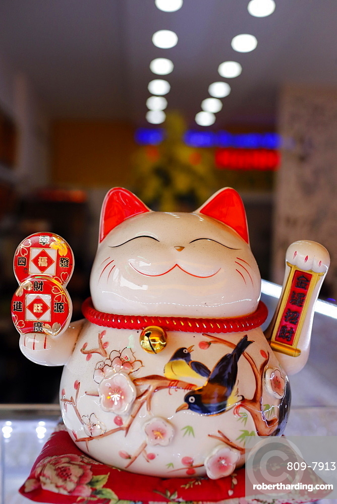 Lucky Cat in shop symbolizing good luck and good fortune, Ho Chi Minh City, Vietnam, Indochina, Southeast Asia, Asia