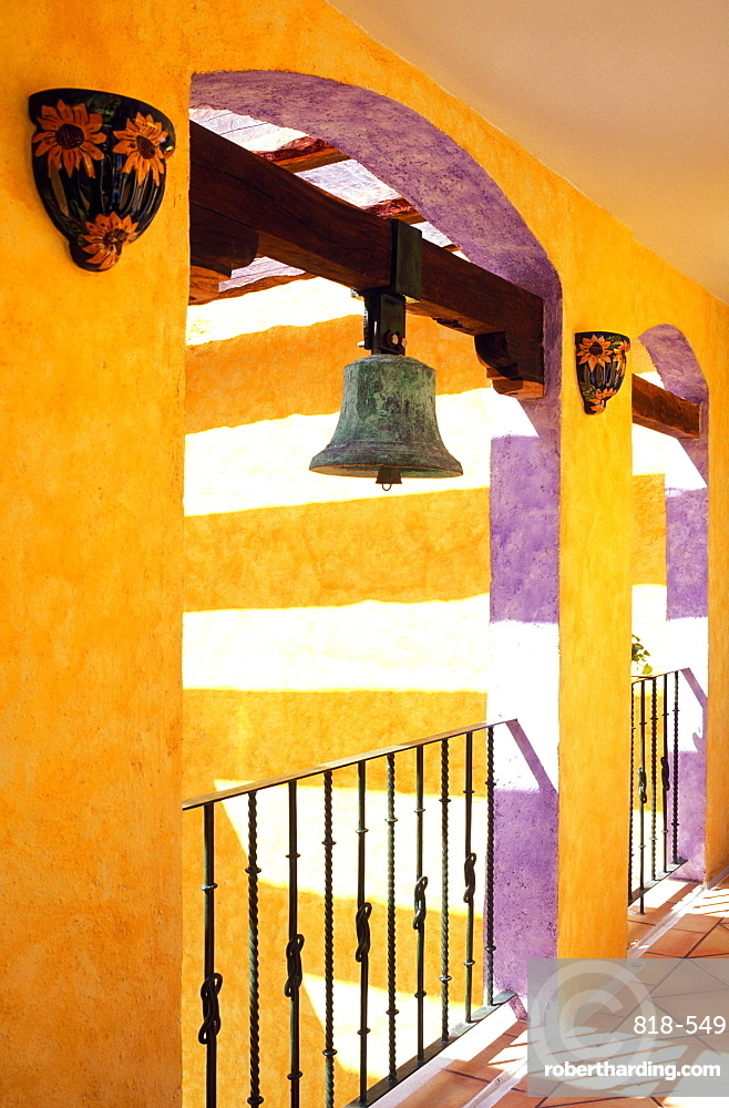 Colorful corridor in hotel with antique brass bell, Playa del Carmen, Yucatan, Mexico, North America