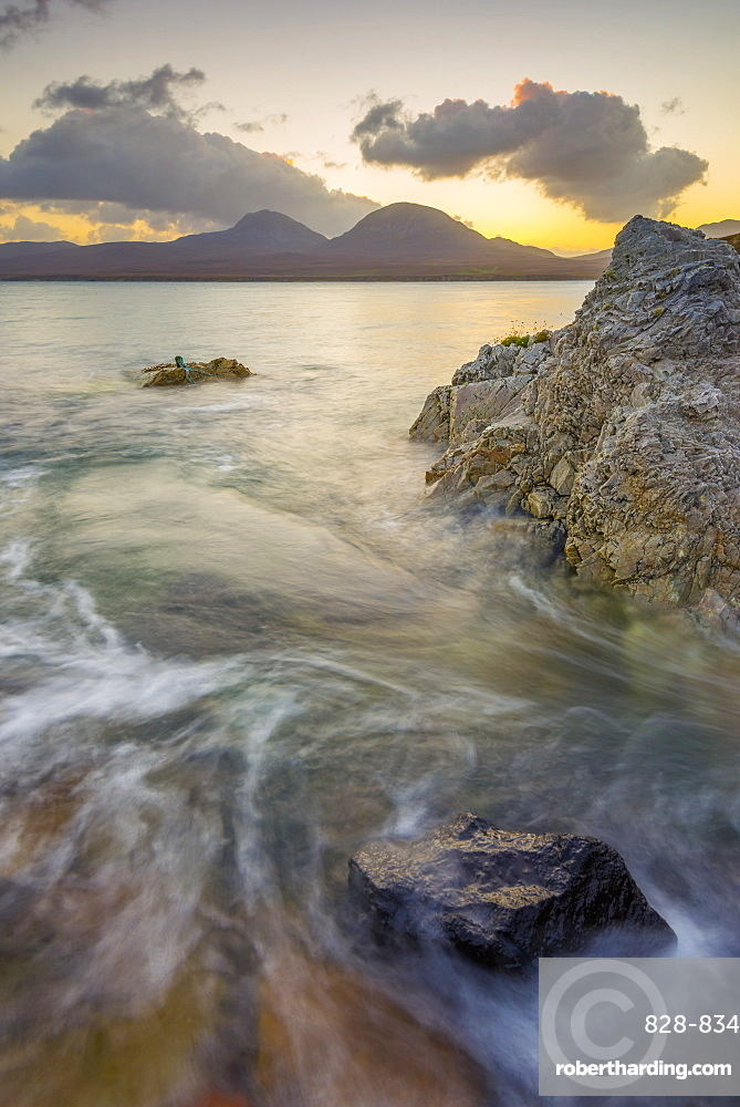 Isle of Jura and Paps of Jura Mountains across Bunnahabhain Bay and Sound of Islay from Islay, Argyll and Bute, Scotland, United Kingdom, Europe