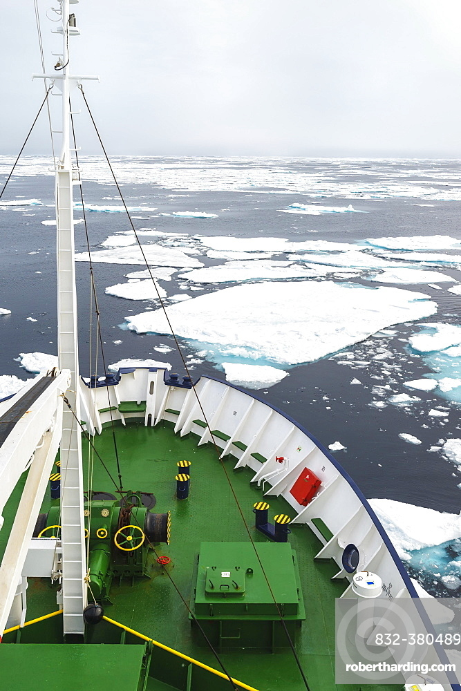 Expedition Boat navigating through melting pack ice, Arctic Ocean, 81° North and 26° East, Svalbard Archipelago, Norway, Europe