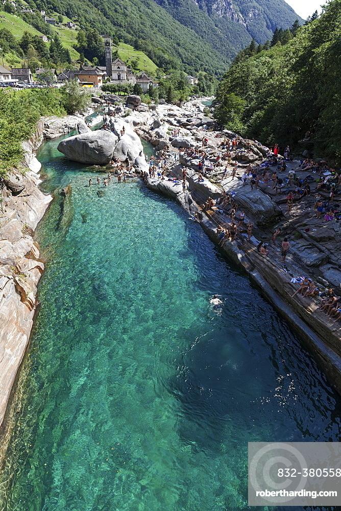Bathing people on rocks at Verzasca, near Lavertezzo, Verzascatal, Valle Verzasca, Canton Ticino, Switzerland, Europe