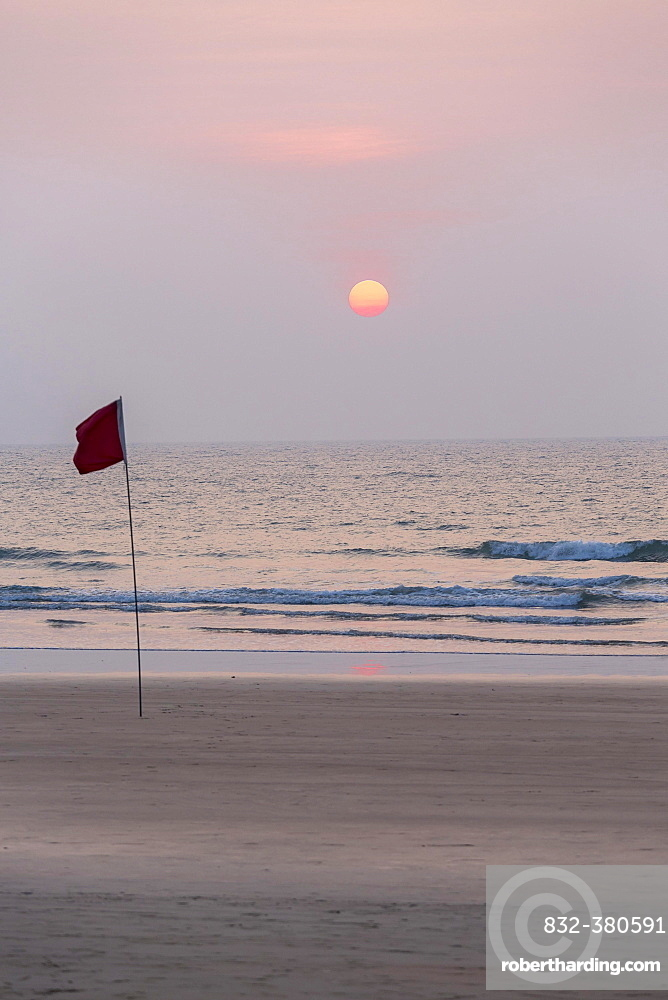Lifeguard flag in sunset at Agonda Beach, Goa, India, Asia