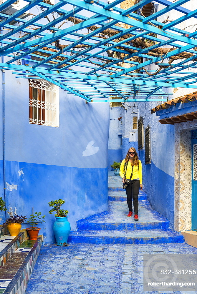 Young woman in the old town, Blue house walls, Medina of Chefchaouen, Chaouen, Tangier-Tétouan, Kingdom of Morocco
