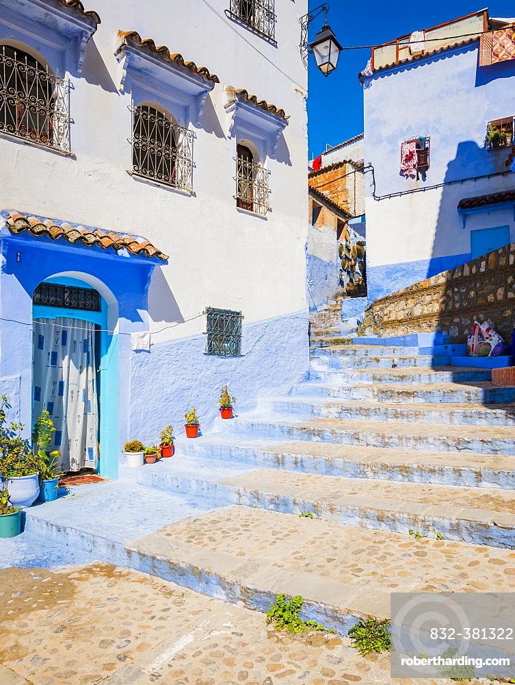 Stairs through narrow alley, blue houses, medina of Chefchaouen, Chaouen, Tanger-Tétouan, Morocco, Africa