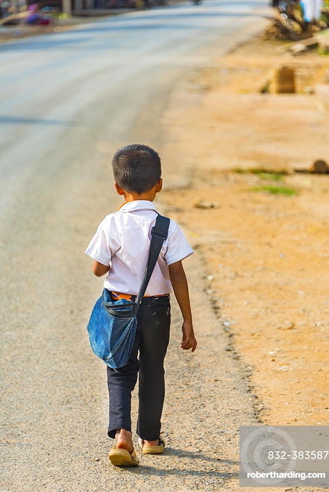 Little boy on way to school, Nong Khiaw, Luang Prabang Province, Laos, Asia