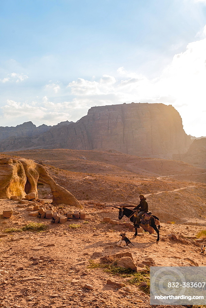 Man on a donkey, Nabataean city Petra, near Wadi Musa, Jordan, Asia