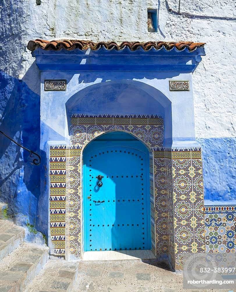 Facade, blue entrance door with colourful patterned tiles, blue house, Medina of Chefchaouen, Chaouen, Tangier-Tetouan, Morocco, Africa