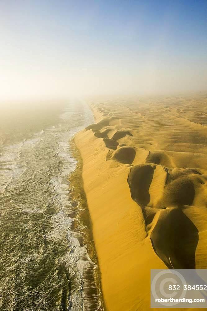 Aerial view, sandunes of the Namib desert floating in the Atlantic ocean, Namibia, Africa