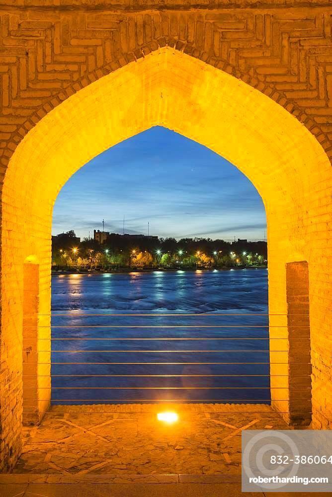 View through bridge arch, Si-o-se Pol Bridge or Allah-Verdi Khan Bridge at dusk, Esfahan, Iran, Asia
