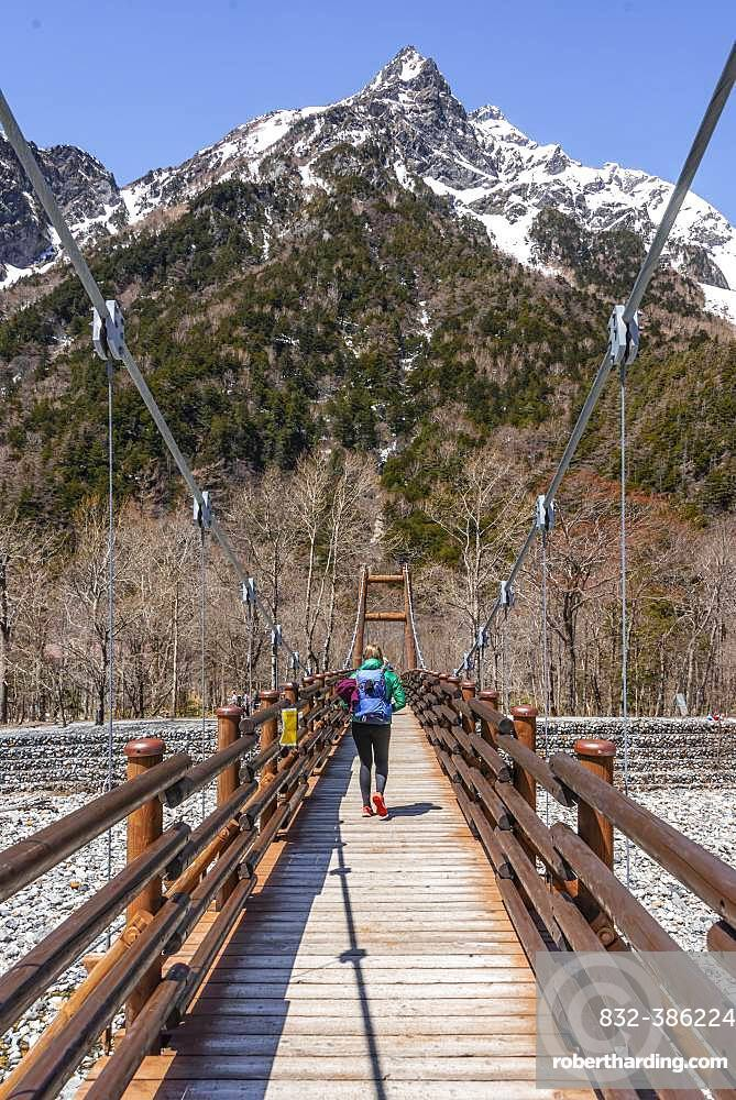 Woman walking over Myojin Bridge, Japanese Alps, Kamikochi, Matsumoto, Nagano, Japan, Asia