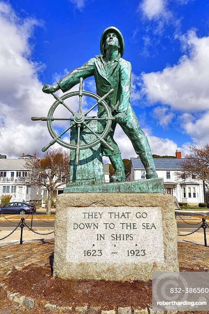 Bronze statue of a man at the wheel, Gloucester fisherman's Memorial, Memorial for castaways with inscription from biblical Psalm, Gloucester, Cape Ann, Massachusetts, New England, USA, North America