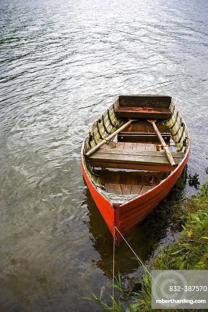 Red rowing boat on the banks of the Erlaufsee near Mariazell, Styria, Austria, Europe
