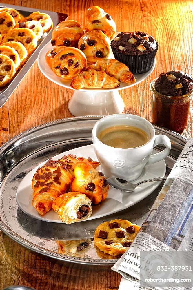 Breakfast, coffee break, pastries, croissants and muffins, coffee and newspaper, Germany, Europe