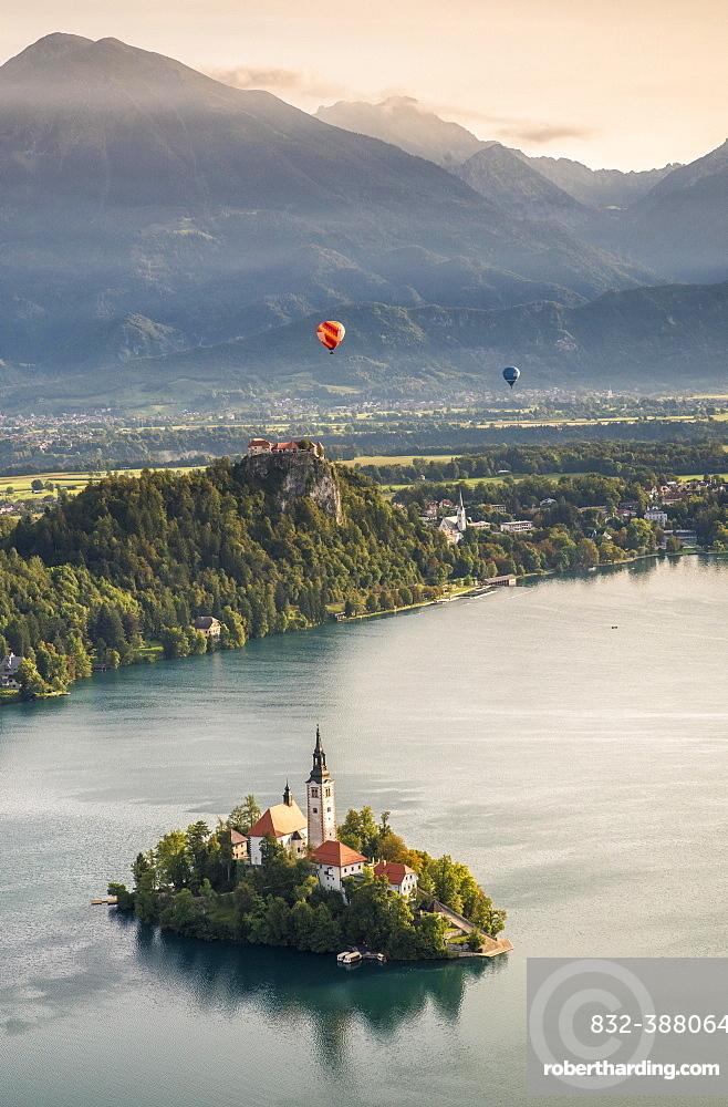 Lake Bled with Bled Castle and Blejski Otok Island with St. Mary's Church, behind it Karavanke, Bled, Slovenia, Europe