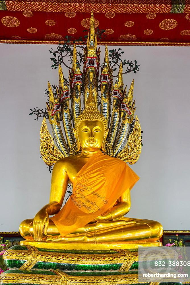 Buddha meditating under the protection of a seven-headed Naga snake, Wat Pho, Bangkok, Thailand, Asia