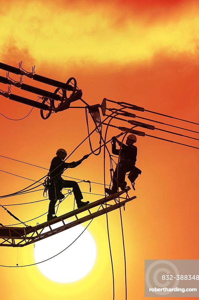 Digital Composing, High voltage engineers working on high voltage pylons, Baden-Wuerttemberg, Germany, Europe