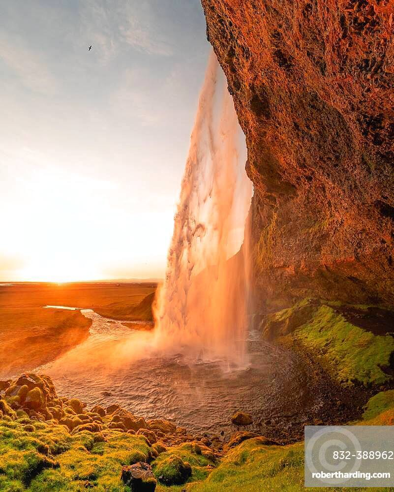 Seljalandsfoss waterfall at midnight sun, Southern Iceland, Iceland, Europe
